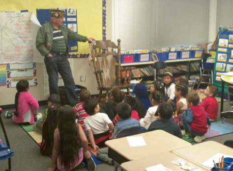 Post 8870 member Dan White visited classrooms at Odyssey ES